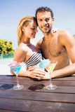 Happy couple embracing in the pool Stock Photos