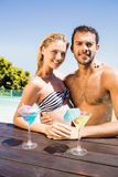 Happy couple embracing in the pool Royalty Free Stock Photography