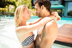 Happy couple embracing in the pool. And looking at each other Stock Photo