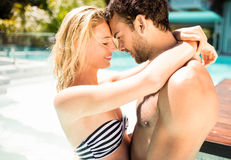Happy couple embracing in the pool. And looking at each other Royalty Free Stock Image