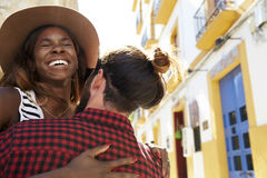 Happy couple embracing on vacation, close up, eyes closed Stock Image