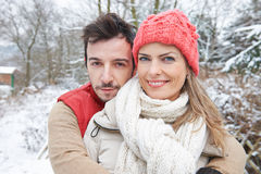 Happy couple embracing in winter Stock Photos