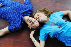 Happy couple in empty apartment Stock Photos
