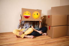Happy couple. Couple with empty boxes on heads Stock Photography