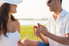 Happy couple with engagement ring in gift box Royalty Free Stock Image