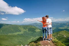 Happy couple enjoy beautiful nature in the mountains Stock Photo