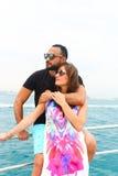 Happy Couple enjoy cruse trip at Dubai. Tow sweet couple enjoy honey moon at sea on yacht Stock Photography