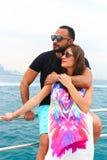 Happy Couple enjoy cruse trip at Dubai. Tow sweet couple enjoy honey moon at sea on yacht Royalty Free Stock Photo