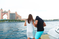 Happy Couple enjoy cruse trip at Dubai. Tow sweet couple enjoy honey moon at sea on yacht Royalty Free Stock Images