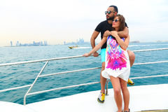 Happy Couple enjoy cruse trip at Gulf. Tow sweet couple enjoy honey moon at sea on yacht Royalty Free Stock Photos