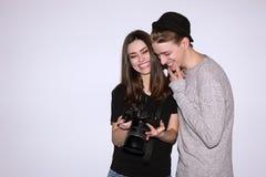 Happy couple enjoy with digital camera Stock Photo