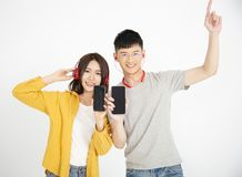 couple enjoy music from smart phone stock photo