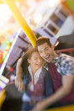 Happy couple enjoy in riding ferris wheel Royalty Free Stock Photos