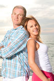Happy couple enjoy summer day at a beach. Stock Image