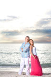 Happy couple enjoy summer day at a beach. Stock Photography