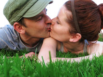 Happy couple enjoy summer day in the park. Royalty Free Stock Photos