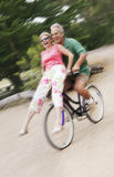 Happy Couple Enjoying Bicycle Ride Stock Image