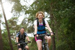 Happy couple enjoying a bike ride in nature Stock Photo