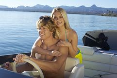 Happy Couple Enjoying Boat Ride Royalty Free Stock Image