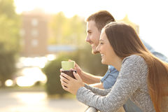Happy couple enjoying breakfast in a balcony Royalty Free Stock Image