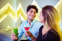 Happy couple enjoying cocktail in nightclub Stock Image