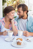 Happy couple enjoying coffee together Stock Photos