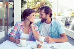 Happy couple enjoying coffee together Stock Images