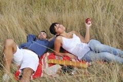 Happy couple enjoying countryside picnic Stock Photography