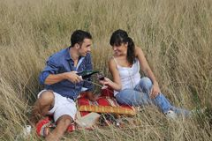Happy couple enjoying countryside picnic Royalty Free Stock Photo