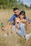 Happy couple enjoying countryside picnic Stock Image