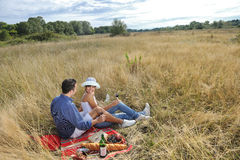Happy couple enjoying countryside picnic Royalty Free Stock Image