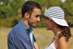Happy couple enjoying countryside picnic Royalty Free Stock Images