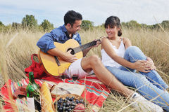 Happy couple enjoying countryside picnic Stock Images