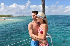 Happy couple enjoying the cruise in caribbean islands Stock Photos