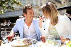 Happy couple enjoying eating lunch in restaurant. Couple eating lunch at restaurant Stock Images
