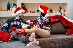 Happy couple enjoying in the holidays and playing with dog Stock Images
