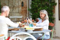 Happy couple enjoying lunch on terrace Stock Photography