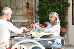 Happy couple enjoying lunch on terrace Stock Photography