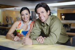 Happy Couple Enjoying Martinis Royalty Free Stock Image