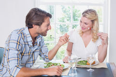 Happy couple enjoying a meal together Royalty Free Stock Photo