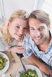 Happy couple enjoying a meal together Royalty Free Stock Photography