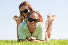 Happy couple enjoying in a park Stock Photography