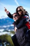 Happy couple enjoying a piggyback ride Stock Image