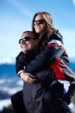 Happy couple enjoying a piggyback ride Stock Photo