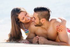 Happy couple enjoying on sandy beach. At vacation together Royalty Free Stock Images