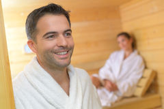 Happy couple enjoying sauna together at spa. Happy couple enjoying the sauna together at the spa Stock Photos