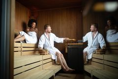 Happy couple enjoying the sauna together at the spa royalty free stock photo