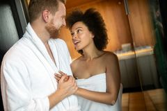 Happy couple enjoying the sauna together at the spa royalty free stock images