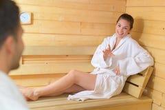Happy couple enjoying sauna together at spa. Happy couple enjoying the sauna together at the spa Royalty Free Stock Photo