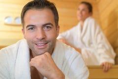 Happy couple enjoying sauna together at spa. Happy couple enjoying the sauna together at the spa Stock Photography
